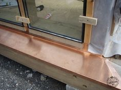 Glazing Detail and Copper Flashing on Oak Frame Glazing