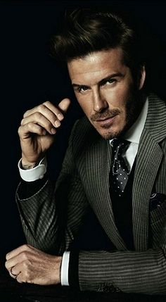 David Beckham usually doesn't do it for me, but he does look very handsome in this photo.