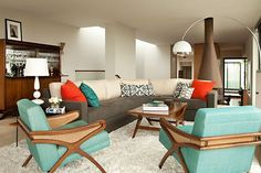 Retro modern space using accent and accessories to add color...aquamarine and orange is a great color combination!