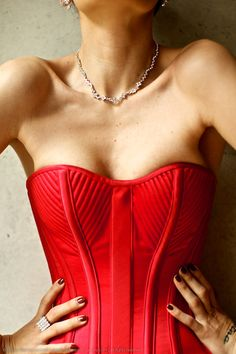 great red corset with nice cut details to inspire http://LuxeFlesh.ca/ designs..