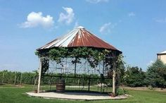 This corn crib was designed with an open face to function as a welcoming center for a large group of people or main event.  A corn crib with this particular look would serve well as the backdrop to a country wedding, or as the main hub at a special event.