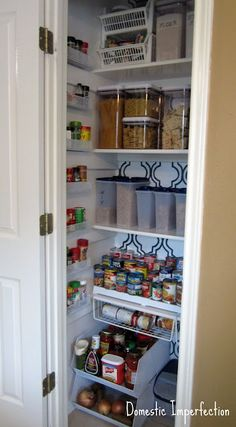 This is a good use of a small space for a pantry. I like the use of otherwise empty space for storing spices and small packets on the side. Also like the order of the space, using similar storage containers on each shelf and adding the two level storage bins to the floor space to maximize area.