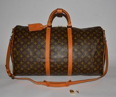 Louis Vuitton Keepall Bandouliere 55 Brown Travel Bag. Save 71% on the Louis…