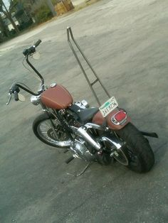 Good idea on shortening the fender but keeping the orig tail light. Sissy bar is sweet too.