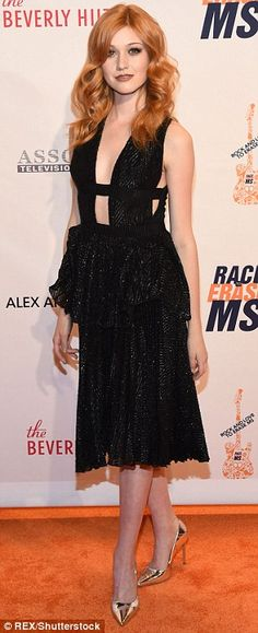 Stunner: Katherine McNamara wore a daring black dress with shimmering heels, opting to wear her red locks loose and wavy
