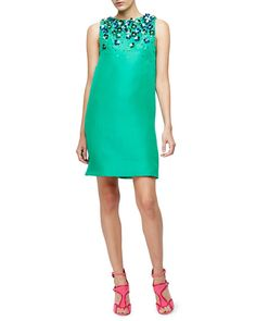 "Monique Lhuillier woven dress with graduated metallic floral embellishments. Approx. length: 35.5""L down center back. Jewel neckline. Sleeveless; moderate shoulder coverage. Empire waist; shift silhou"