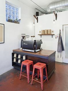 Flat Track Coffee  - almost exactly what I'd like to have for a coffee roastery.  Just a nice station to test and entertain a customer or two.