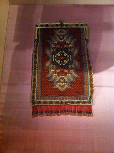 Kralentasje in de vorm van een orientaals vloerkleed
