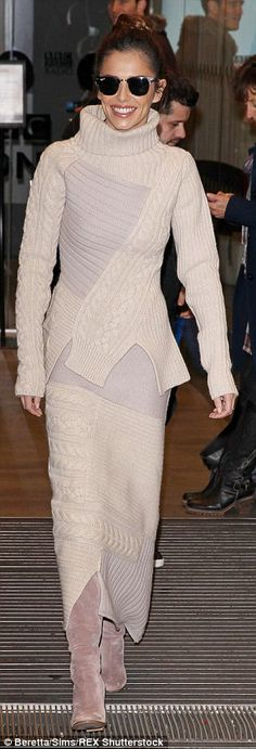 Bold style: Layering the look even more, The X Factor judge paired the look with mink knee-high boots