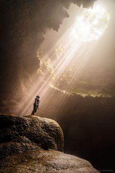 travelgurus:    Sunbeams illuminate the vertical cave of Grubug,   Jomblang,  Central Java, Indonesia by  Kristian Maglalang     Travel Gurus - Follow for more Nature Photographies!