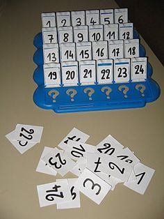 """""""Guess Who"""" game with numbers let kids practice with number properties. """"Is your number greater than 10?"""" """"Is your number even?"""""""