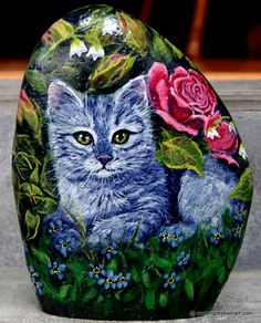 cute little kitten painted on a freestanding rock surrounded with pink roses, valentines day gifts
