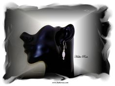 These earrings are handcrafted with sterling silver, Swarovski crystals and quartz crystal focal bead.