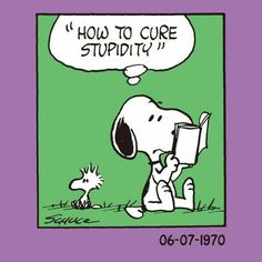 "Snoopy is reading a book called, ""How to cure stupidity."""