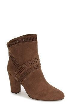 A chunky heel and laser-cut detailing have these suede booties right on trend for fall.
