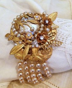 Satin matte gold and vintage pearls done up Haskell style, by Judy Jones King.   Find Satin Matte Brass, which is vintage style brass with 18k gold plating three mils thick, at http://www.bsueboutiques.com