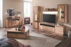 Wohnwand bestehend aus Lowboard, Vitrine, Regal und Hängeschrank kombinierbar mit passendem Sideboard und Couchtisch in Wildeiche abgesetzt mit geschwärzten Akzenten. #moebelhaus#wohnzimmer#wohnwand#moebel#interior#wohnidee#wohnen#living#einrichten#einrichtung#design#livingroom#meinwohlfühlort#komfortwohnen#homesweethome#inneneinrichtung#einrichtung#interiorinspo#furniture#design#livingroom#interiorhome #wohnwand #sideboard #hängeregal #couchtisch #Vitrine #lowboard Sideboard, Flat Screen, Entryway, The Unit, Entertaining, Furniture, Design, Home Decor, Products