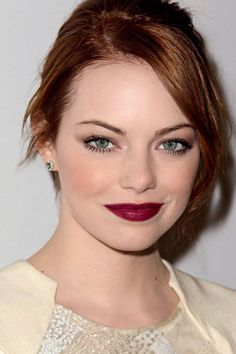 Wow!  Emma Stone is really rocking the wine lips...not easy for a red head...the foundation certainly helps!