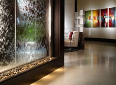 A beautiful and soothing waterwall guides your walk to the elevators.