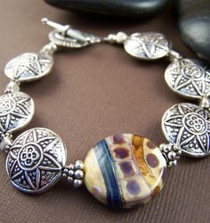 Thai silver with artisan glass beaded bracelet. Coin shaped beads lay flat on your wrist and very comfortable to wear!