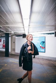 Jessi Frederick of Stylish Gambino wears a black dress with a moto jacket and black boots