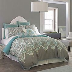 Love this color combination. Have a grey comforter, grey and aqua pillows, and aqua bedside lamps with grey/aqua/white design lampshades. . Trying to decide to paint the walls grey or aqua. Dark brown furniture.