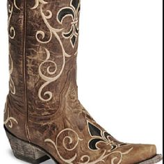 Love! Even though I don't wear cowboy boots very often...these are awesome! I'd totally wear them!  http://www.sheplers.com/old-gringo-womens-evelyn-cowgirl-boot-snip-toe.html