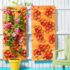 Clusters of brightly colored rings against a warm cedar backdrop provide a trellis for climbing vines and a fence accent to liven a corner of your yard.