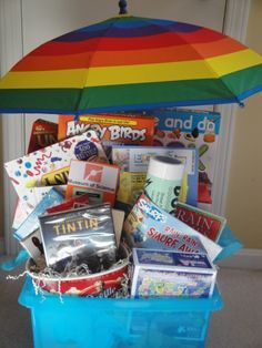 Rainy Day Gift Basket Books crafts games popcorn and Adventures of Tin Tin will help you pass the time Theme Baskets, Themed Gift Baskets, Book Baskets, Diy Gift Baskets, Basket Gift, Gift Basket Themes, Fundraiser Baskets, Raffle Baskets, Homemade Gifts