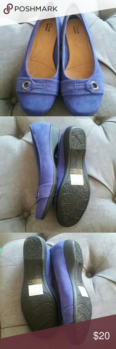 Clark's beautiful blue suede flats loafers Gorgeous cobalt blue Clark's flats. Genuine leather upper. Super comfy. Nearly new. Only damage is small hole on interior of each shoe upper.  See last photo. Not noticeable when wearing. Clarks Shoes Flats & Loafers