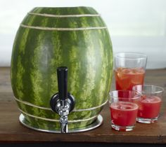 Make a fun DIY watermelon keg for a poolside party, or non alcoholic watermelon punch for the kiddos!