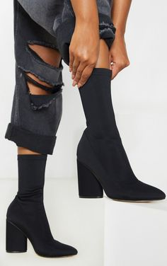 Black Chunky Block Heel Sock Boot nThese sock boots will earn you some serious style points this season Featuring a pull on design and a chunky block heel team these with your fave jeans and a nice top combo nPull on n3 5 Heel