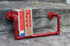 These 1/2″ pipe shelves come in many other colors. Let me know if you want the shelf distressed or not. Great for hanging in your office or next to your favorite place to read. The shelf is 14″ wide a