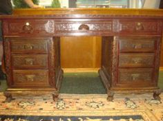 """Lot #487 (26th May, 14) - Live Auctioneers High Relief Carved Chinese Executive Desk: Flat Writing Surface with Carved Floral and Scroll Design Around All 4 Sides and Through Center. Center Drawer Flanked by 4 on Each Side. 61""""W X 32""""D X 32""""T. Some Scuffs."""