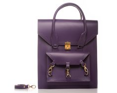 Purple Pelham tote bag can be worn across the body as a cross body bag with a detachable shoulders straps. The structured smooth sturdy cow leather comes with all gold-tone hardware the main front clutch lock its a Swiss-made lock, and with three trigger hooks and D ring hardware. The handle of the bag it's a rolled skinny handle with chunky stitches on both sides of the handle and leather pattern trimmings.  #bag #handbag #tote #purple