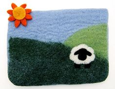 Looking for a cute little bag to store notions, double pointed needles, and other odds and ends? Look no further than this cute sheep in the meadow felted wool bag, a Fair Trade product handmade in Nepal.