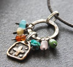 Fine Silver,  Rustic Bronze Cross, Turquoise, Carnelian, Glass and Leather Necklace. $42.00, via Etsy.