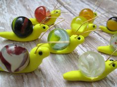 These snails are bright and cheery! This listing is for a set of 3 snails. I hand-sculpted each snail from polymer clay and used wire to form their