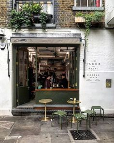A relaxed, well designed coffee shop with a brick exterior. Cafe Shop Design, Coffee Shop Interior Design, Coffee Design, House Design, Small Coffee Shop, Coffee Store, Café Restaurant, Restaurant Design, Coffee Shop Aesthetic