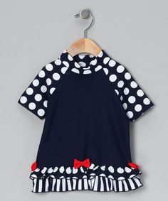 Take a look at this Navy Polka Dot Frill Rashguard - Infant & Girls by Cupid Girl on #zulily today!
