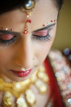 Northern California Indian wedding by Mita Productions with a bride in red.