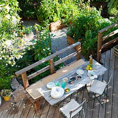 Raised vegetable beds, gravel walkways to cut down on weeds, raised patio deck with picnic table and bench.. LOVE IT.