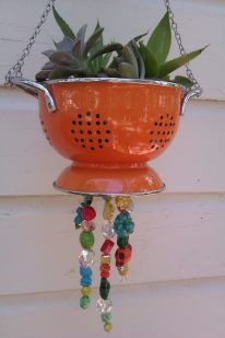 I love my succulents! And I love antique colanders so I turned this one into a wind chime using some of my funky nuggets I make jewelry with.