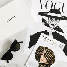 Monochrome flat lay with Vogue and Celine | onlinestylist on Instagram |