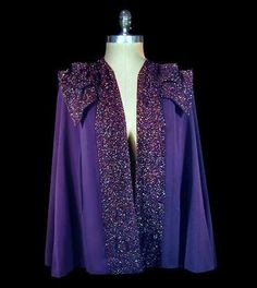Indigo wool cape with beaded double collar and trim, owned by Joan Crawford, ca 1935