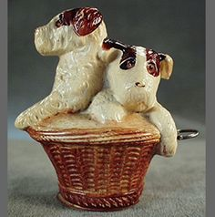Old Figural Celluloid Tape Measure - Terriers in Basket from ogees on Ruby Lane
