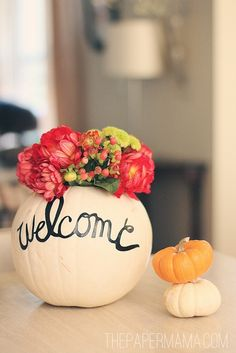 Pumpkin welcome and vase with typography, again, the handmade feel creates a very personal touch.
