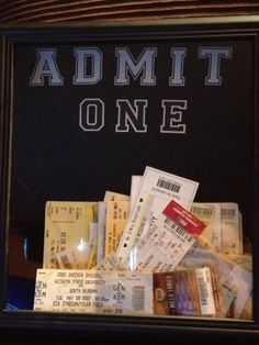 """Admit One shadow box for tickets-- keepsake! NAILED IT. Used a shadow box, gold push pins for """"lights"""" around foam letters, and old ticket stubs from shows, movies, and sports events! Above pic not mine."""