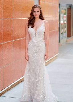 Detailed bridal gown with fit and flare fit with plunging V-neckline Winter Wedding Destinations, Destination Wedding, Wedding Locations, Embroidered Lace, Beaded Lace, Stunning Summer, Bridal Gowns, Wedding Dresses, Space Wedding