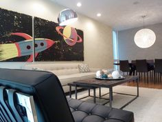 Modern living room in the heart of Chicago with clean lines, soothing color palette, comfortable furniture and a bold rocket ship piece of artwork.